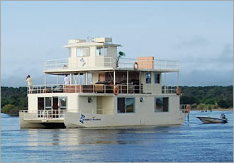 Take a luxury house boating cruise and view game from the river
